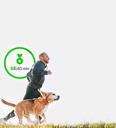 Dog owner running with dog